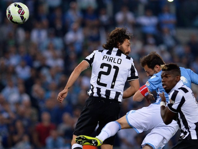 Lazio's defender from Romania Stefan Radu (C) scores during the Italian Tim Cup final match (Coppa Italia) between Juventus and Lazio on May 20, 2015