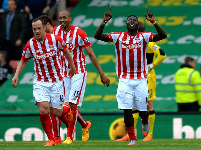 Mame Diouf of Stoke City celebrates scoring their second goal during the Barclays Premier League match between Stoke City and Liverpool at Britannia Stadium on May 24, 2015