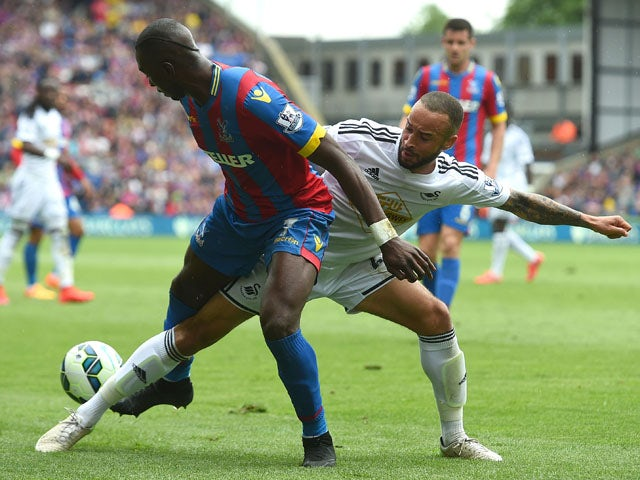 Jazz Richards of Swansea City and Yannick Bolasie of Crystal Palace in action during the Barclays Premier League match between Crystal Palace and Swansea City at Selhurst Park on May 24, 2015