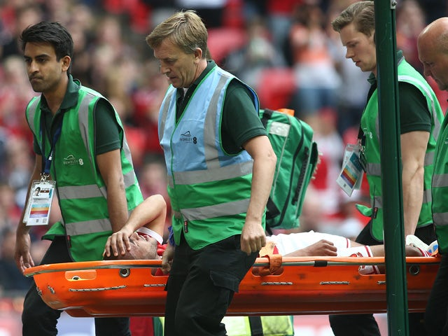 Nathan Thompson of Swindon Town is stretchered off during the League One play-off final between Preston North End and Swindon Town at Wembley Stadium on May 24, 2015