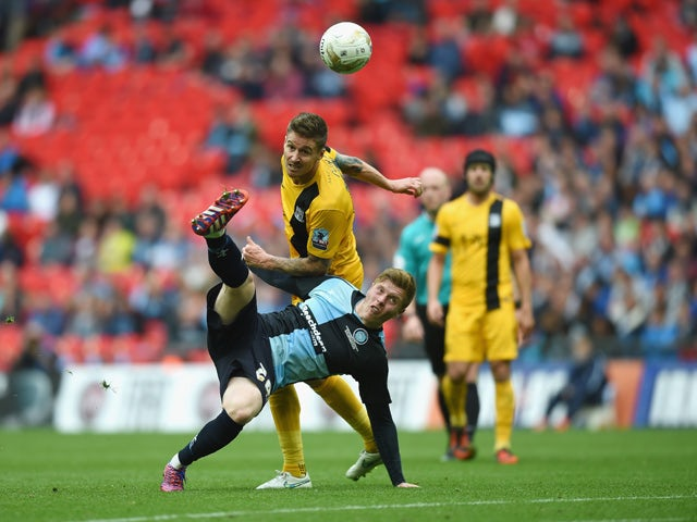 Alfie Mawson of Wycombe in action with Matthew Bloomfield of Southend during the Sky Bet League Two Playoff Final match between Southend United and Wycombe Wanderers at Wembley Stadium on May 23, 2015