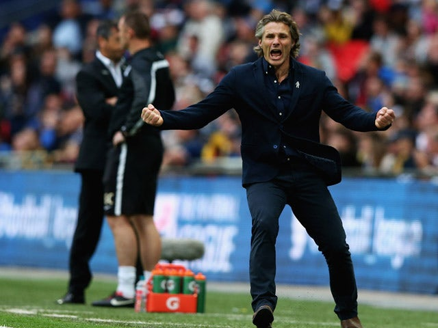 Gareth Ainsworth, manager of Wycombe Wanderers celebrates Joe Jacobson's goal during the Sky Bet League Two Playoff Final between Southend United and Wycombe Wanderers at Wembley Stadium on May 23, 2015
