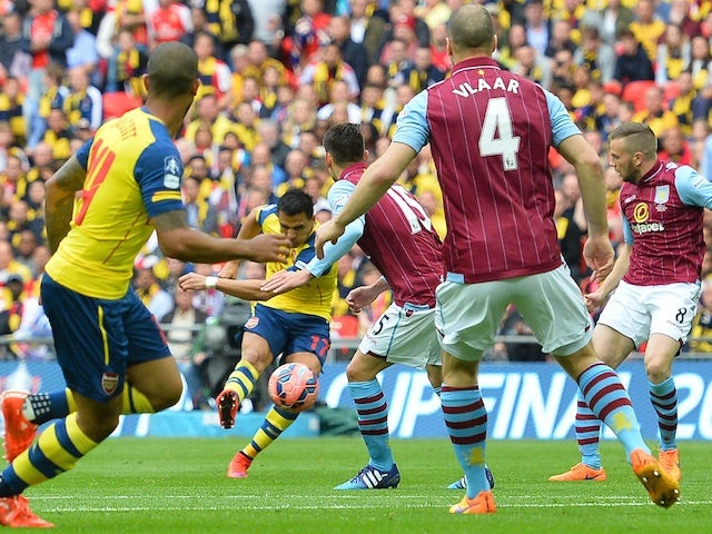 Alexis Sanchez fires home Arsenal's second goal during the FA Cup final against Aston Villa at Wembley on May 30, 2015