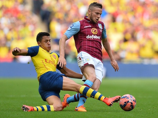 Alexis Sanchez and Tom Cleverley tussle for possession during the FA Cup final at Wembley between Arsenal and Aston Villa on May 30, 2015