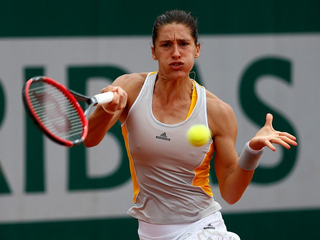 Andrea Petkovic of Germany returns a shot during her women's singles match against Lourdes Dominguez Lino of Spain on day five of the 2015 French Open at Roland Garros on May 28, 2015