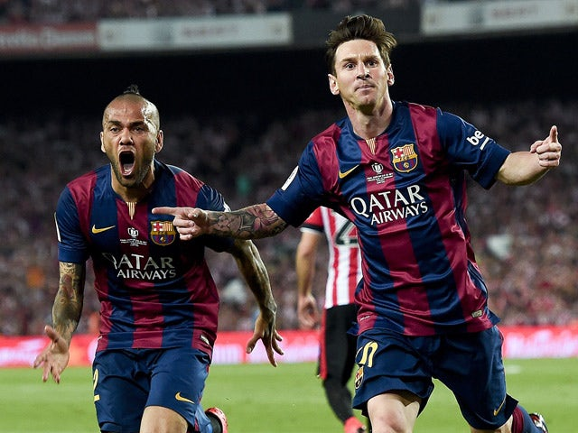 Barcelona's Argentinian forward Lionel Messi celebrates his goal past Barcelona's Brazilian defender Dani Alves during the Spanish Copa del Rey (King's Cup) final football match Athletic Club Bilbao vs FC Barcelona at the Camp Nou stadium in Barcelona on