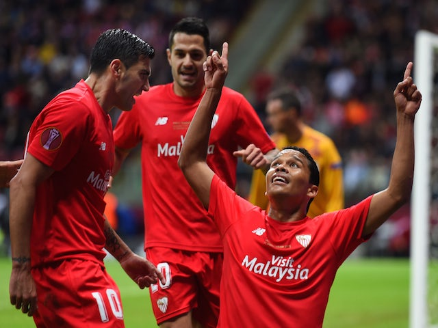 Carlos Bacca of Sevilla celebrates scoring his team's second goal with Jose Antonio Reyes (L) of Sevilla during the UEFA Europa League Final match between FC Dnipro Dnipropetrovsk and FC Sevilla on May 27, 2015