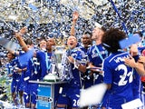 John Terry celebrates with his teammates as Chelsea lift the Premier League trophy on May 24, 2015