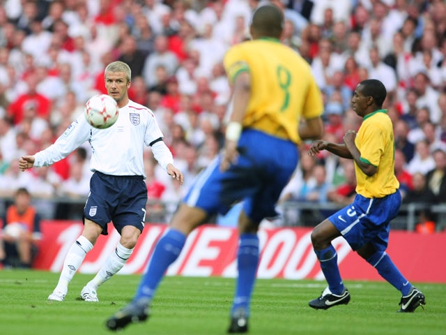 David Beckham of England passes the ball forward during the International Friendly match between England and Brazil at Wembley Stadium on June 1, 2007
