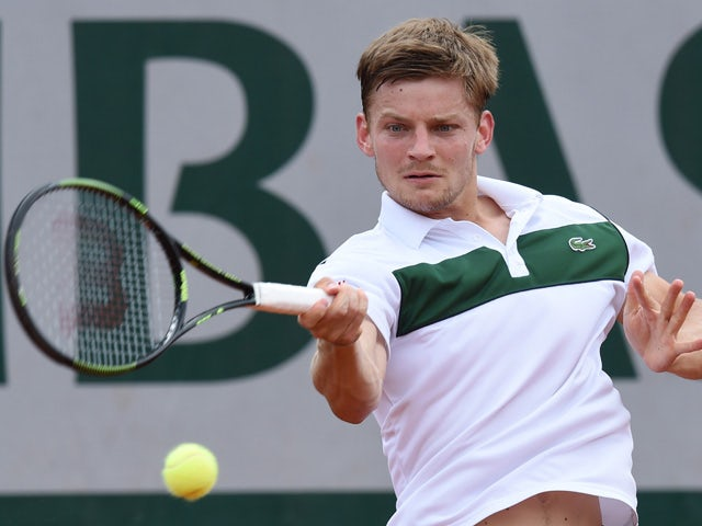 Belgium's David Goffin returns the ball to Colombia's Santiago Giraldo during the men's second round at the Roland Garros 2015 French Tennis Open in Paris on May 28, 2015