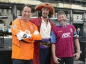David Seaman and Andy Townsend pose with Captain Morgan himself as a waft of dark rum permeates the brisk morning air on May 30, 2015