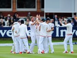 An assortment of England teammates celebrate as they take firm control on day five of the First Test with New Zealand on May 25, 2015