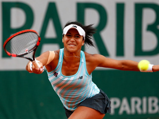 Heather Watson of Great Britain returns a shot during her Women's Singles match against Sloane Stephens of the United States on day five of the 2015 French Open at Roland Garros on May 28, 2015