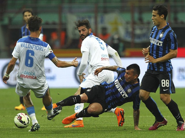 Mirko Valdifior of Empoli FC competes for the ball with Gary Alexis Medel of FC Internazionale Milano during the Serie A match between FC Internazionale Milano and Empoli FC at Stadio Giuseppe Meazza on May 31, 2015