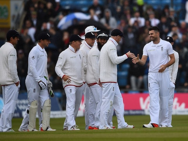 James Anderson celebrates taking his 400th Test wicket for England during day one of the Second Test with New Zealand on May 29, 2015