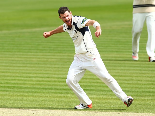 James Harris of Middlesex celebrates after getting the wicket of Paul Coughlin of Durham to end the innings during day three of the LV County Championship match between Middlesex and Durham at Lord's Cricket Ground on May 4, 2015