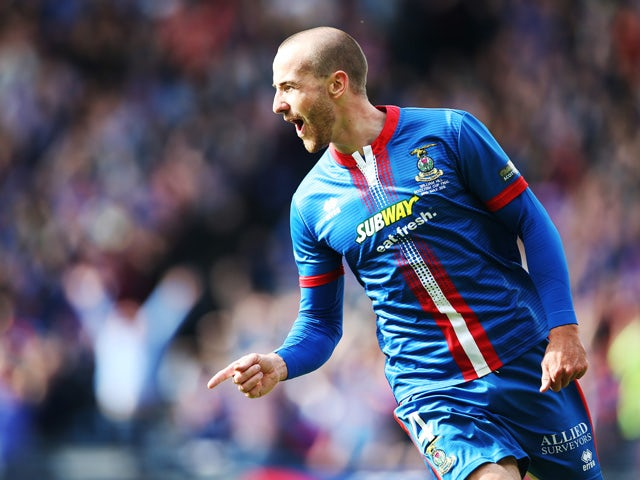 James Vincent of Inverness Caledonian Thistle celebrates after scoring during the William Hill Scottish Cup Final match between Falkirk and Inverness Caledonian Thistle at Hampden Park on May 30, 2015