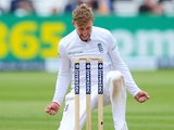 Joe 'Joseph' Root drops to his knees after claiming the wicket of New Zealand's Corey Anderson on May 25, 2015