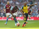 Aston Villa defender Jores Okore and Theo Walcott of Arsenal contest for the ball during the FA Cup final at Wembley on May 30, 2015