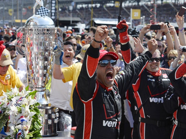 Juan Pablo Montoya of Colombia driver of the #2 Team Penske Chevrolet Dallara celebrates after winning the 99th running of the Indianapolis 500 mile race at the Indianapolis Motor Speedway on May 24, 2015
