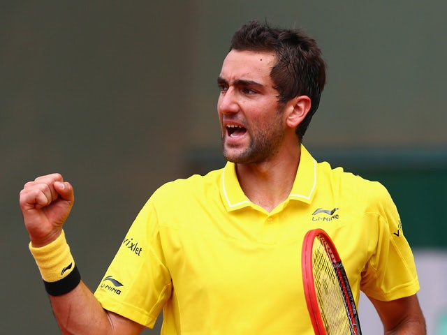 Marin Cilic of Croatia celebrates a point during his Men's Singles match against Andrea Arnaboldi of Italy on day five of the 2015 French Open at Roland Garros on May 28, 2015
