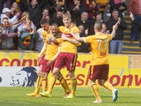 Lionel Ainsworth of Motherwell celebrates his goal making it 2:0 with team mates during the Scottish Premiership play-off final 2nd leg between Motherwell and Rangers at Fir Park on May 31, 2015