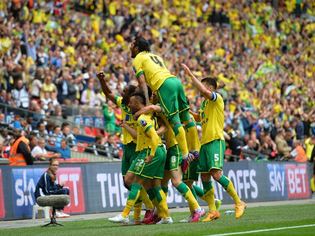 Norwich City players celebrate their second goal scored by Norwich City's English midfielder Nathan Redmond (2L) during the English Championship play off final football match between Middlesbrough and Norwich City at Wembley Stadium in London on May 25, 2