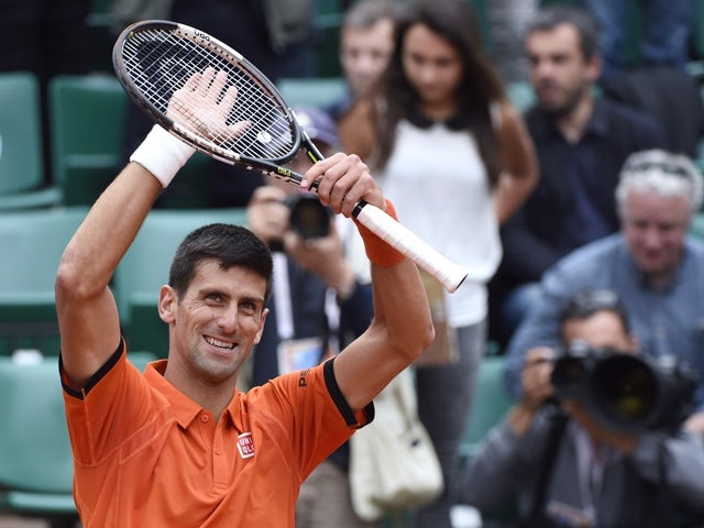 Serbia's Novak Djokovic celebrates after winning his match against Luxemburg's Gilles Muller during the men's second round of the Roland Garros 2015 French Tennis Open in Paris on May 28, 2015