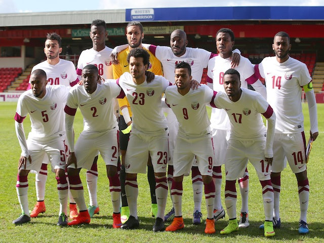 Qatar players line up prior to the International friendly match between Northern Ireland and Qatar at The Alexandra Stadium on May 31, 2015