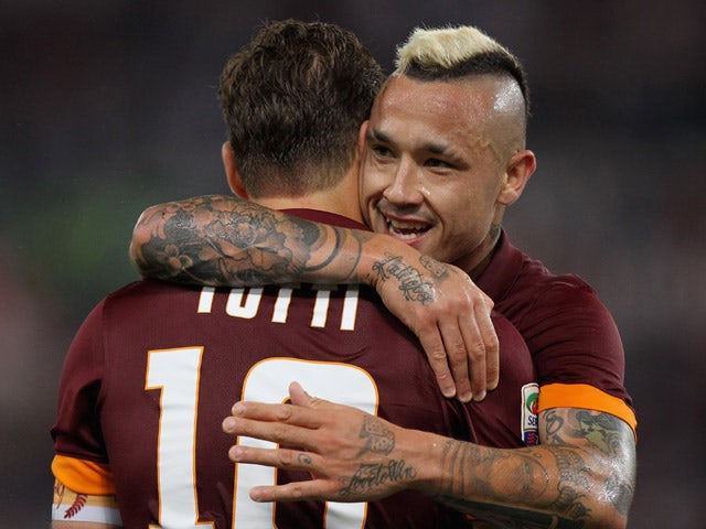 Francesco Totti of AS Roma celebrates after scoring his team's first goal with his team-mate Radja Nainggolan during the Serie A match between AS Roma and US Citta di Palermo at Stadio Olimpico on May 31, 2015
