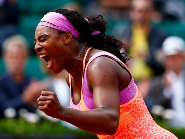 Serena Williams of the United States celebrates match point in her Women's Singles match against Anna-Lena Friedsam of Germany on day five of the 2015 French Open at Roland Garros on May 28, 2015