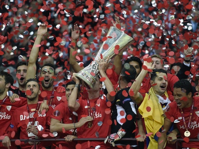 Sevilla players celebarte with throphy after the UEFA Europa League final football match between FC Dnipro Dnipropetrovsk and Sevilla FC at the Narodowy stadium in Warsaw, Poland on May 27, 2015