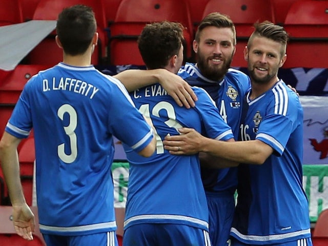 Northern Ireland's Stuart Dallas (2R) is congratulated after scoring during the international friendly football match between Qatar and Northern Ireland at the Alexandra Stadium in Crewe on May 31, 2015
