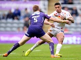 Willie Tonga (R) of Catalans Dragons tackled by Aaron Murphy of Huddersfield Giants during the Super League match between Catalans Dragons and Huddersfield Giants at St James' Park on May 31, 2015
