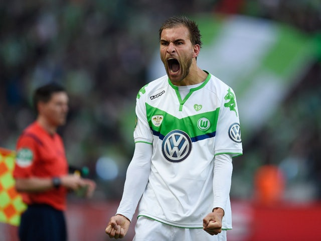 Wolfsburg's Dutch striker Bas Dost celebrates scoring during the German Cup DFB Pokal final football match between BVB Borussia Dortmund and VfL Wolfsburg at the Olympic Stadium in Berlin on May 30, 2015