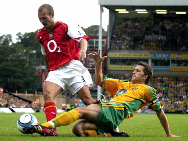 Arsenal's Freddy Ljungberg (L) is challenged by Norwich's Adam Drury for the ball during their Premiership match 28th August, 2004