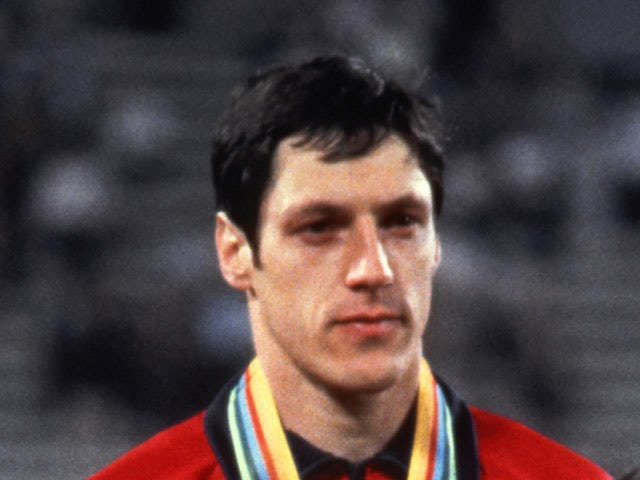 Alan Wells of Great Britain listens to the national anthem on the podium after winning the men's 100m final 25 July 1980