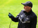 Coach Alberto Salazar of the Nike Oregon Project times athletes as they train on the grass at the Nike campus on April 13, 2013