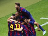 Gerard Pique of Barcelona (top) celebrates with team mates after the goal scored by Ivan Rakitic during the UEFA Champions League Final between Juventus and FC Barcelona at Olympiastadion on June 6, 2015