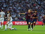 Ivan Rakitic of Barcelona celebrates scoring the opening goal with Neymar during the UEFA Champions League Final between Juventus and FC Barcelona at Olympiastadion on June 6, 2015