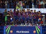 Neymar of Barcelona lifts the trophy as he celebrates victory with team mates after the UEFA Champions League Final between Juventus and FC Barcelona at Olympiastadion on June 6, 2015