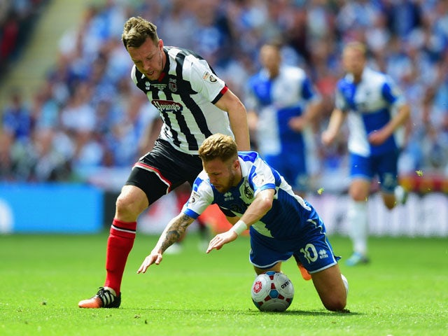Carl Magnay of Grimsby Town challenges Matt Taylor of Bristol Rovers during the Vanarama Conference Playoff Final match between Grimsby Town and Bristol Rovers at Wembley Stadium on May 17, 2015