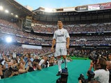 New Real Madrid player Cristiano Ronaldo is presented to a full house at the Santiago Bernabeu stadium on July 6, 2009