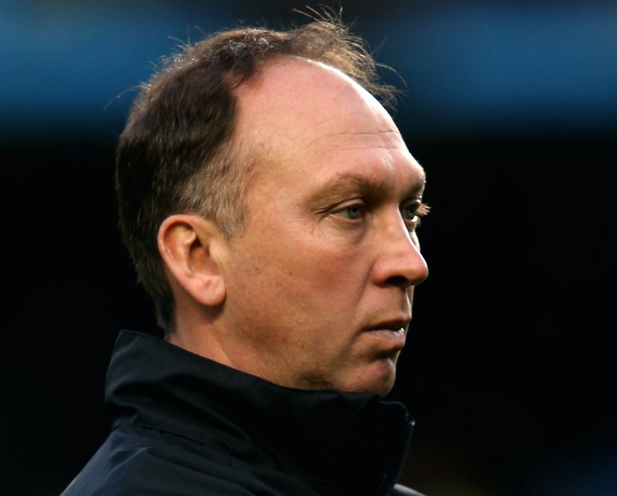 David Platt the Manchester City assistant coach watches his players warm up prior to kickoff during the Barclays Premier League match between Chelsea and Manchester City at Stamford Bridge on November 25, 2012