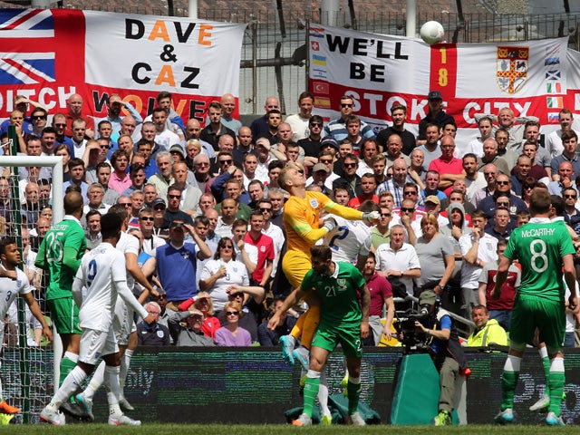 England's goalkeeper Joe Hart punches the ball clear during the international friendly football match between Republic of Ireland and England at Aviva Stadium in Dublin on June 7, 2015