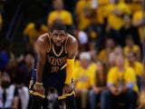 Cleveland Cavaliers point-guard Kyrie Irving looks on during game one of the NBA Finals on June 4, 2015