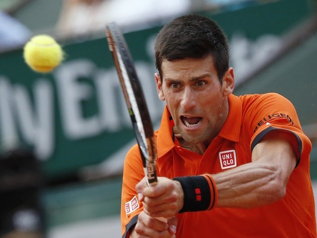 Novak Djokovic plays a backhand stroke during the French Open semi-final against Andy Murray at Roland Garros on June 5, 2015