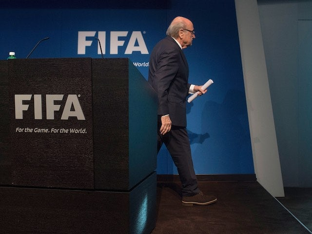 FIFA president Sepp Blatter leaves the stage after announcing his intention to resign on June 2, 2015