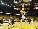 Golden State Warriors point-guard Stephen Curry drives to the basket during game one of the NBA Finals at Oracle Arena on June 4, 2015