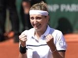 Switzerland's Timea Bacsinszky celebrates after winning her match against Belgium's Alison Van Uytvanck during the women's quarter-finals of the Roland Garros 2015 French Tennis Open in Paris on June 3, 2015